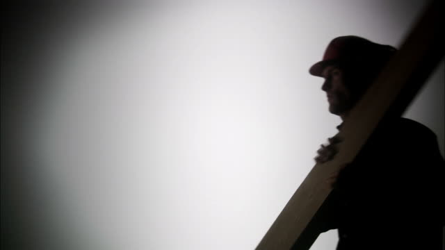 the silhouette of a construction worker. - carpenter stock videos and b-roll footage