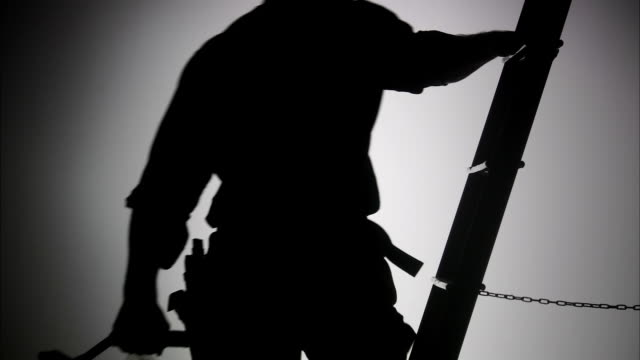 the silhouette of a construction worker. - hammer stock videos and b-roll footage