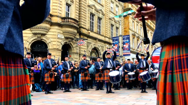 the simon fraser university play in buchanan street during the piping live glasgow international piping festival on august 15 2018 in glasgow... - scotland stock videos & royalty-free footage