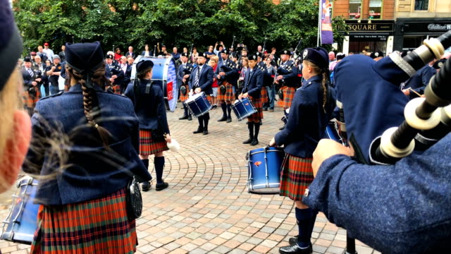the simon fraser university play in buchanan street during the piping live glasgow international piping festival on august 15 2018 in glasgow... - bagpipes stock videos & royalty-free footage