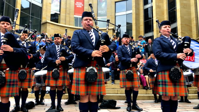 the simon fraser university play in buchanan street during the piping live glasgow international piping festival on august 15 2018 in glasgow... - glasgow scotland stock videos & royalty-free footage