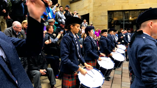 the simon fraser university play in buchanan street during the piping live! glasgow international piping festival on august 15, 2018 in glasgow,... - bagpipes stock videos & royalty-free footage