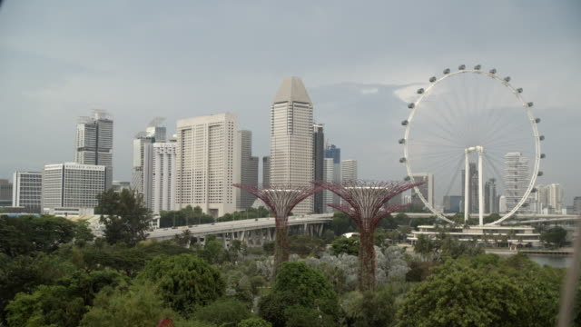 the singapore flyer and the city / singapore - singapore flyer stock videos and b-roll footage