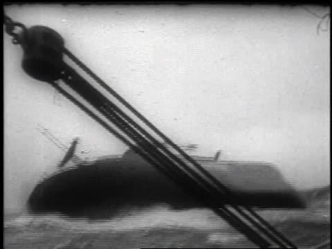 vídeos de stock e filmes b-roll de the sinking of the american freighter ship flying enterprise off coast of united kingdom after long struggle / united kingdom - 1952