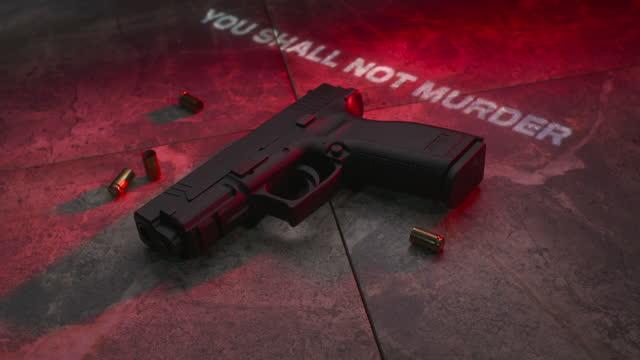 the sixth commandment on a handgun with tilt - terrorism stock videos & royalty-free footage