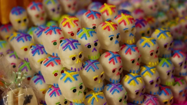 the skeletons-shaped cookie for celebrating day of the dead in patzcuaro, janitzio island in michoacan state - 作法点の映像素材/bロール