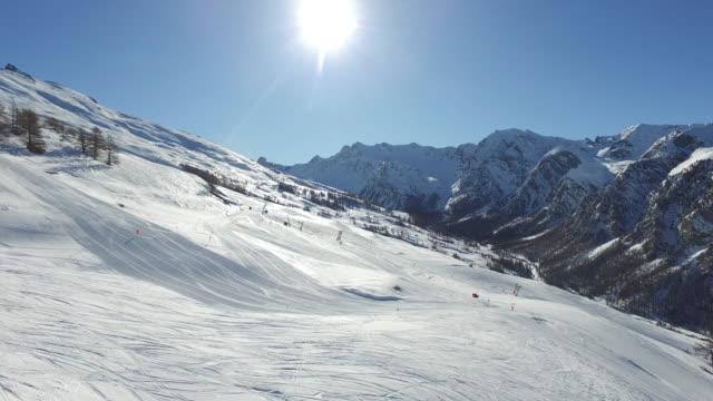 the ski resort in winter in the french alps - skiurlaub stock-videos und b-roll-filmmaterial