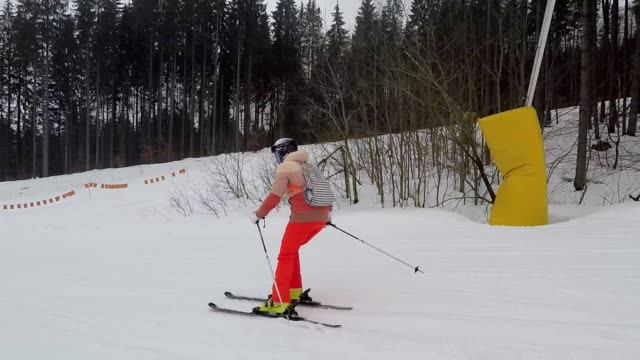 The skier descends down the slope.