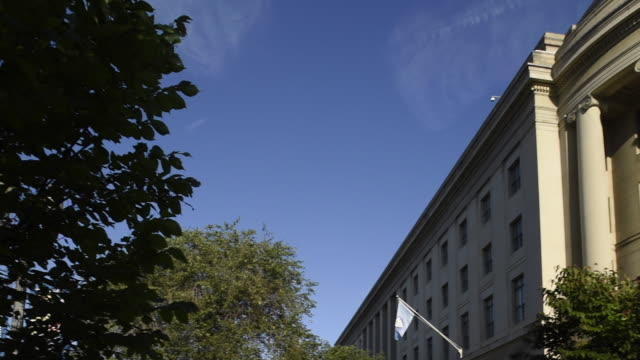 the skies above the federal trade commission building in washington, dc are clear. - federal building stock videos and b-roll footage