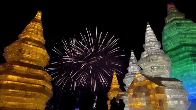 the skies light up over harbin as the northern chinese city officially launches its 33rd ice and snow festival - schneefestival stock-videos und b-roll-filmmaterial