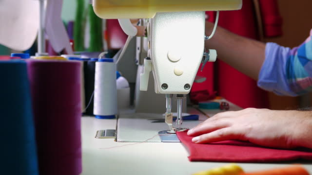 the skillful hands of the tailor - fashion designer stock videos and b-roll footage