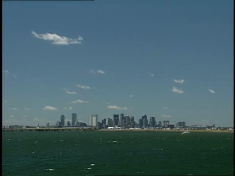 the skyline of boston with its rocky shore is seen across boston harbor. - boston massachusetts stock videos & royalty-free footage