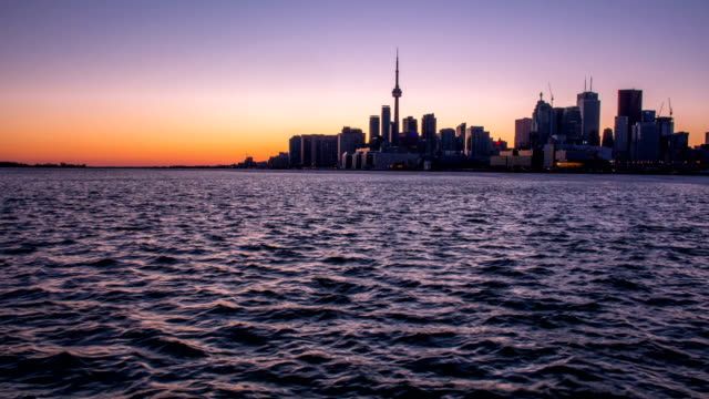 the skyline of toronto during the sunset - toronto stock videos & royalty-free footage