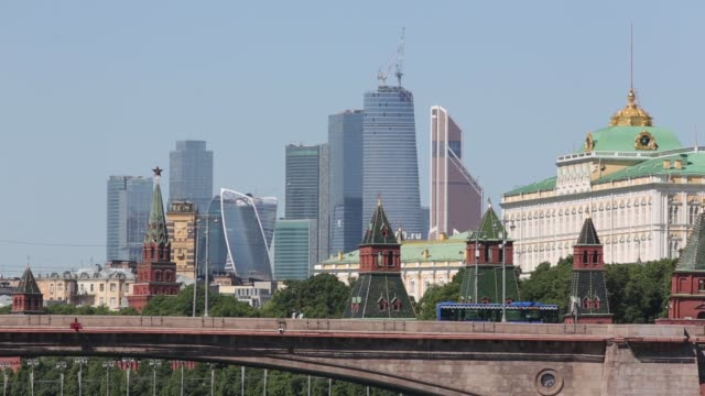 the skyscrapers of moscow city business district left stand on the horizon beyond the kremlin right on the banks of the moscow river in moscow russia... - river moscva stock videos & royalty-free footage