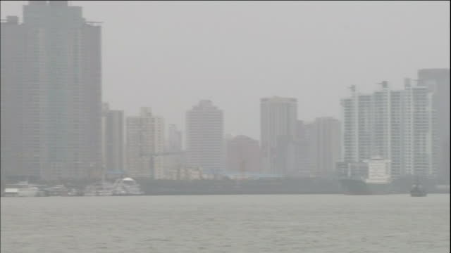 The skyscrapers of Shanghai are shrouded in air pollution