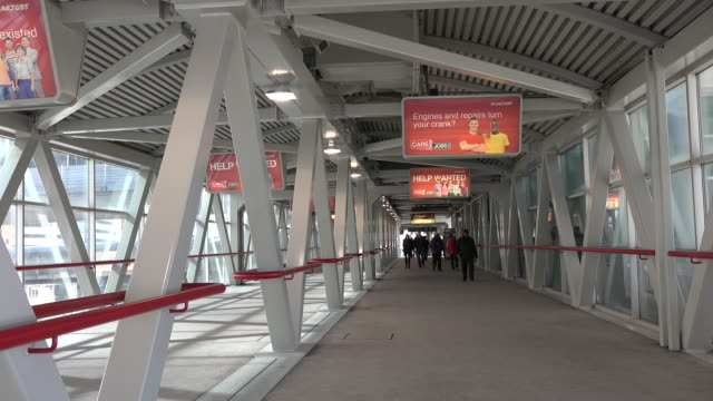 the skywalk is an approximately 500 metre enclosed walkway connecting union station to the cn tower and the rogers centre part of toronto's path... - cn tower stock videos & royalty-free footage