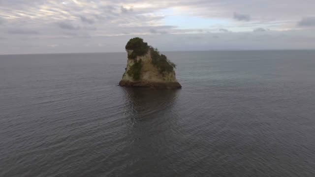 stockvideo's en b-roll-footage met the small island in the shape of a piece of cheese very close to el morro beach in the pacific ocean in tumaco, colombia - pacific ocean