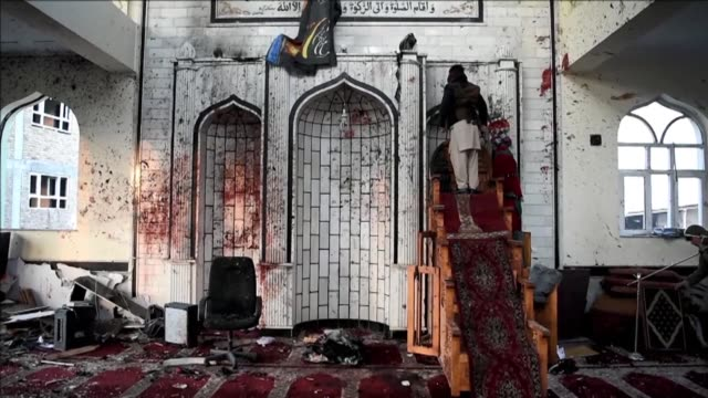 The smell of death permeates the Imam Zaman mosque in Kabul hours after dozens of Shiite worshippers were slaughtered by a suicide bomber during...