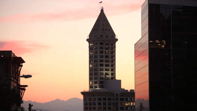 The Smith Tower in Seattle Washington at sunset on a summer evening.