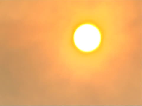 the smog infested city of linfen in china general view of a bright sun in an orange sky - skadedjursangrepp bildbanksvideor och videomaterial från bakom kulisserna