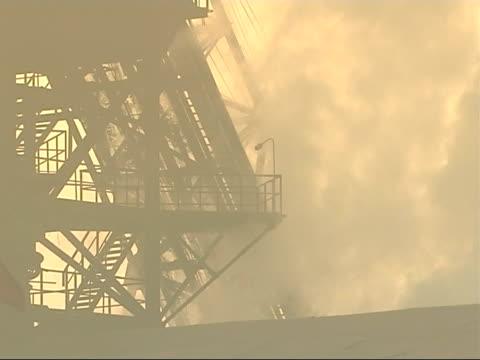 the smog infested city of linfen in china general views of smoke rising around the factory's central structures - skadedjursangrepp bildbanksvideor och videomaterial från bakom kulisserna