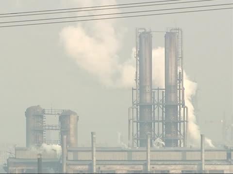 the smog infested city of linfen in china general views of steel works factory with smoke billowing from buildings - skadedjursangrepp bildbanksvideor och videomaterial från bakom kulisserna