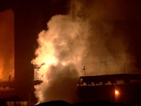 the smog infested city of linfen in china night general views of smoke and fires in and around the factory good - skadedjursangrepp bildbanksvideor och videomaterial från bakom kulisserna