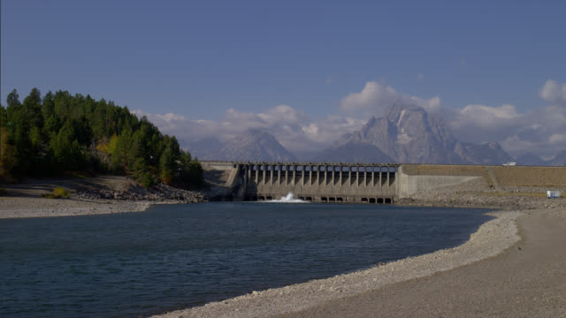 The Snake River flows toward the Jackson Lake Dam in Grand Teton National Park.