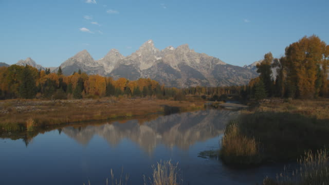 The Snake River reflects the Teton Range in the Grand Teton National Park.