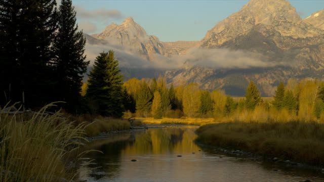 the snake river winds past schwabacher's landing in grand teton national park. - wyoming stock videos & royalty-free footage