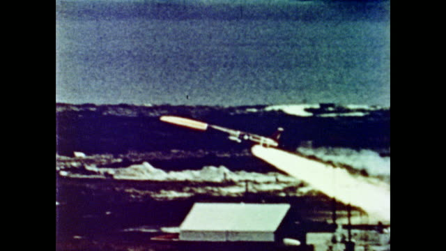 the snark intercontinental missile takes off drops its warheads on target and seamlessly flies through a blue sky - anno 1962 video stock e b–roll
