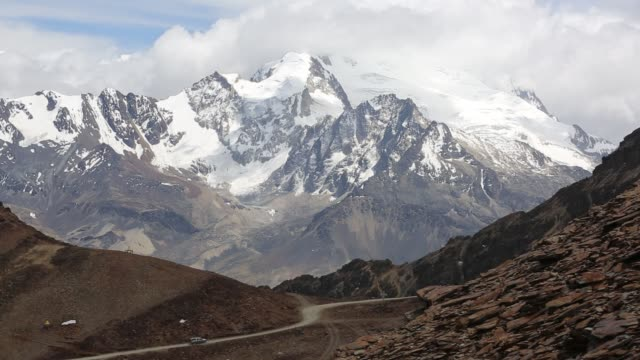 the snow and glacier covered andean peak of huayna potosi in bolivia. - bolivia stock videos & royalty-free footage