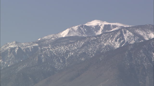 the snow-capped sierra nevadas overlook owens lake. - californian sierra nevada stock videos & royalty-free footage