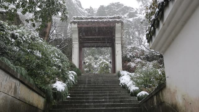 the snowscape of a yard gate in wansong academy,hangzhou,zhejiang,china - courtyard stock videos & royalty-free footage