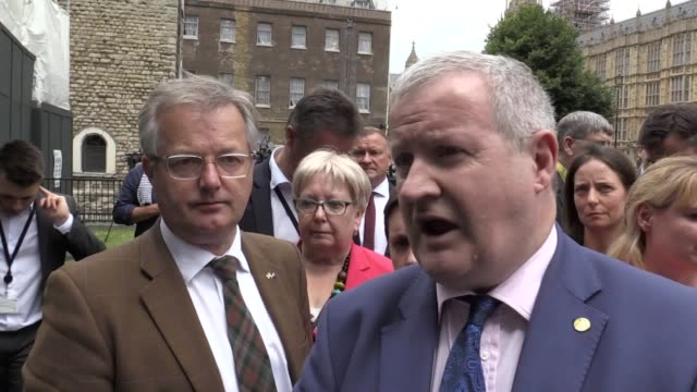 The SNP's leader in Westminster Ian Blackford speaks after his party's MPs stage a walkout from the House of Commons after the speaker ordered Mr...