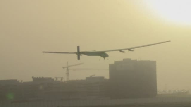 the solar impulse 2 piloted by andre borschberg of switzerland takes off from al bateen airport heading to muscat where it is expected to land later... - circumnavigation stock videos & royalty-free footage