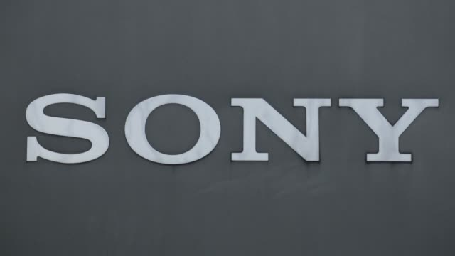 vídeos de stock e filmes b-roll de the sony corp headquarters stands in tokyo japan on monday feb 16 gvs of sony signage and buildings - sony