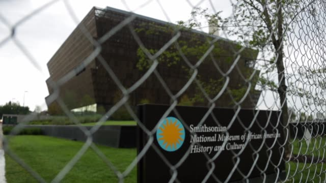 The soontobeopened Smithsonian National Museum of African American History and Culture is seen behind a fence September 1 2016 in Washingotn DC The...