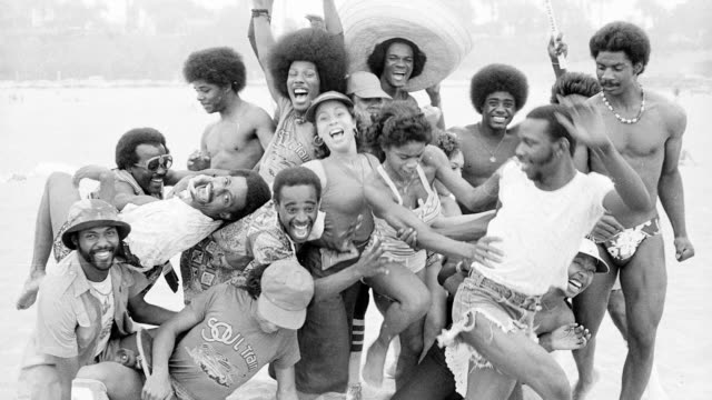 """""""the soul train gang"""" dancers from the tv show soul train pose for a series of portraits on the beach in circa 1975 in santa monica, california. - television show stock videos & royalty-free footage"""