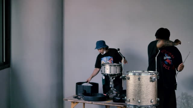 the sound technician tunes the drums and hangs up the microphones before the concert - drum percussion instrument stock videos & royalty-free footage
