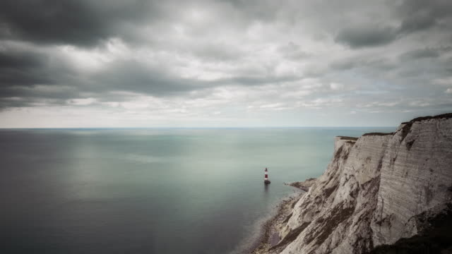 the south coast of england looking across the english channel with the cliffs at beachy head and beachy head lighthouse in the foreground - english channel stock videos and b-roll footage