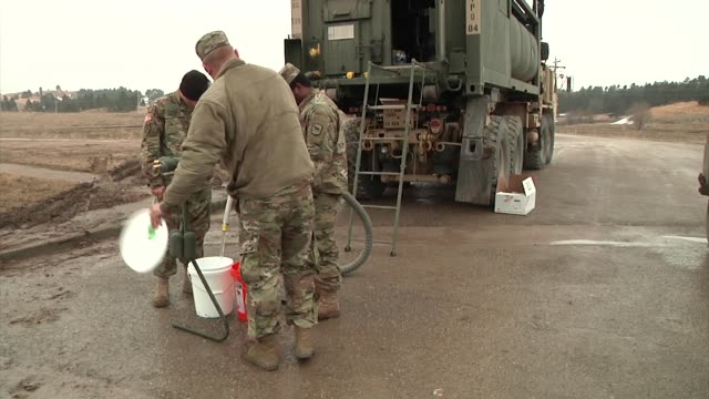 the south dakota national guard deployed to the american indian pine ridge reservation to distribute water to residents who have been trapped in... - national guard stock videos and b-roll footage