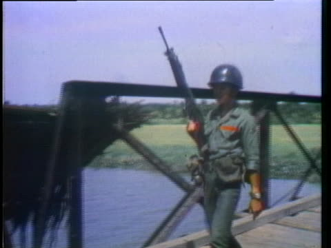 the south vietnamese flag flies above a bridge. - (war or terrorism or election or government or illness or news event or speech or politics or politician or conflict or military or extreme weather or business or economy) and not usa stock videos & royalty-free footage