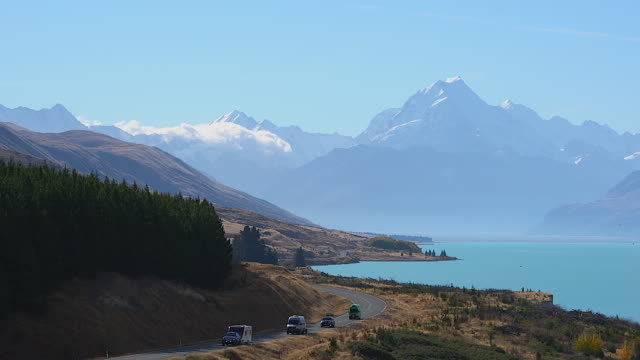 the southern alps, road to mt cook, the highest mountain in new zealand. scenic highway drive along lake pukaki in aoraki mt cook national park, south island of new zealand. - new zealand stock videos & royalty-free footage