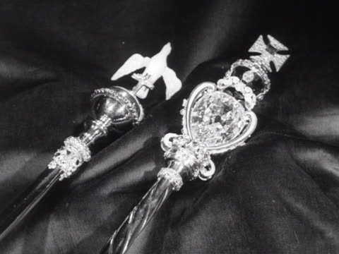 The Sovereign's Sceptre and the Sceptre with the Dove are decorated with precious stones