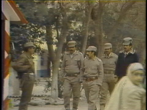 the soviet presence is scarcely felt in the khyber region of afghanistan as afghan border guards exchange pleasantries and a pakistani border guard... - crime or recreational drug or prison or legal trial stock videos & royalty-free footage