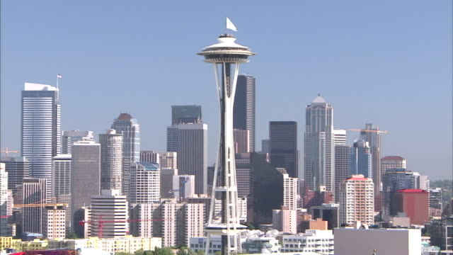the space needle marks seattle's skyline in downtown near starbucks headquarters. - space needle stock videos & royalty-free footage