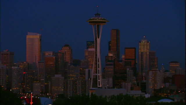 the space needle towers above the city of seattle, washington. - washington mutual tower stock videos & royalty-free footage