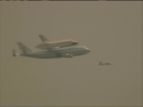 the space shuttle discovery, mounted atop a modified airplane, flies over the washington monument and the capitol in washington d.c. before landing... - space shuttle discovery stock videos & royalty-free footage