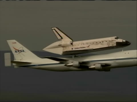 the space shuttle discovery, mounted atop a modified airplane, flies over washington d.c. before landing at dulles airport. - space shuttle discovery stock videos & royalty-free footage